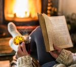 reading book by the fire