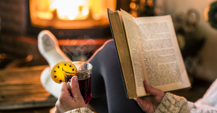 reading book in front of fire